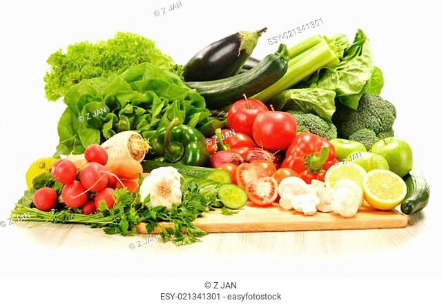 Composition with raw vegetables isolated on white