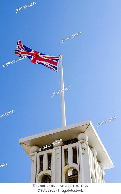 Union Jack flying on one of the towers on Brighton Pier, East Sussex, England
