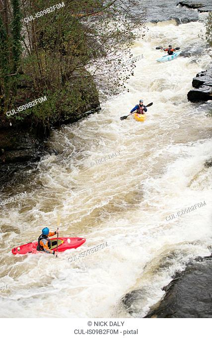 High angle view of kayakers paddling River Dee white water rapids, Llangollen, North Wales