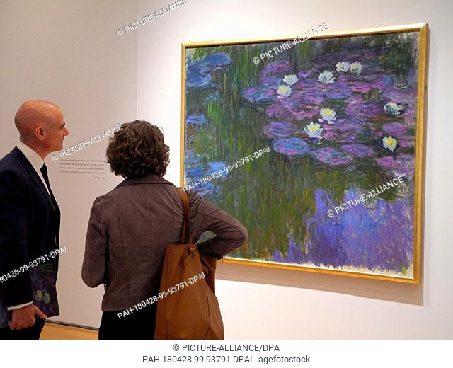 """27 April 2018, New York, USA: ..The painting """"""""Nympheas en fleur"""""""" by the painter Claude Monet hangs in the Christie's auction house in New York"""