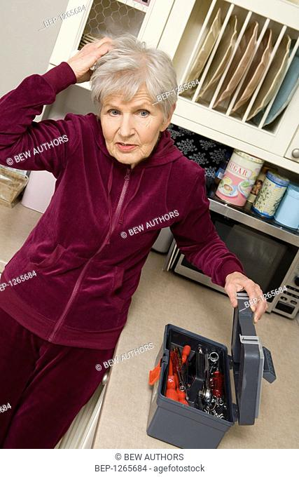 Old lady dealing with monkey wrench