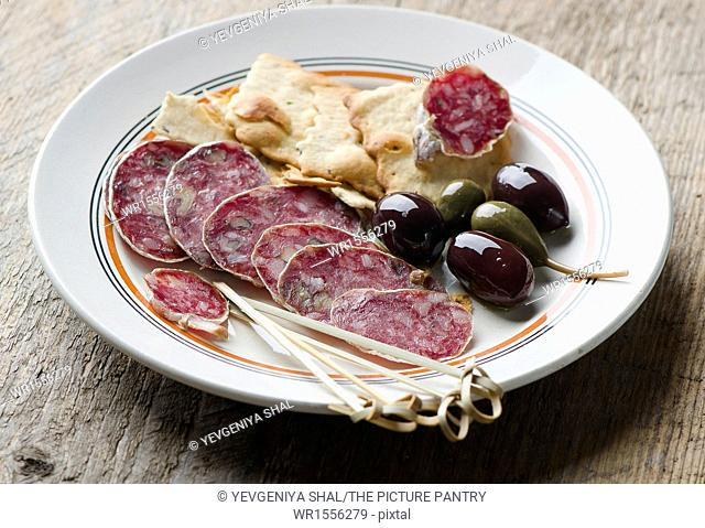 Salami on a white plate