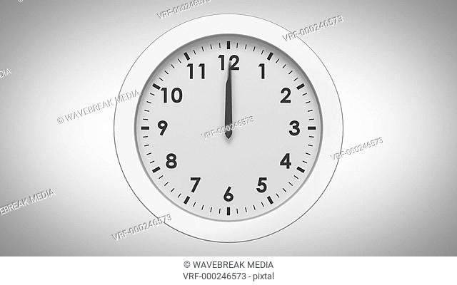 Clock ticking on white background