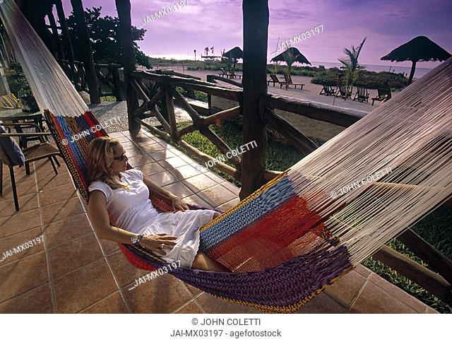 Woman in hammock, olbox Island, Cancun, Yucatan, Mexico