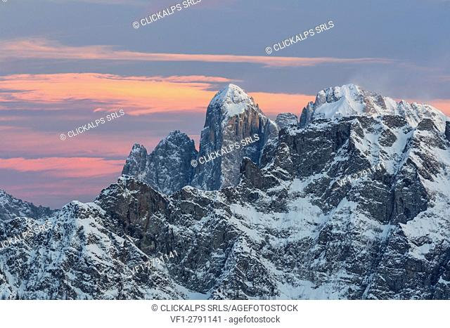 Europe, Italy, Veneto, Belluno. Winter sunset from Col Margherita. In the background the edge of mount Agner in evidence, Dolomites