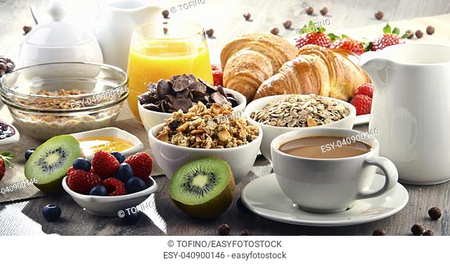 Breakfast served with coffee, orange juice, croissants, cereals and fruits. Balanced diet