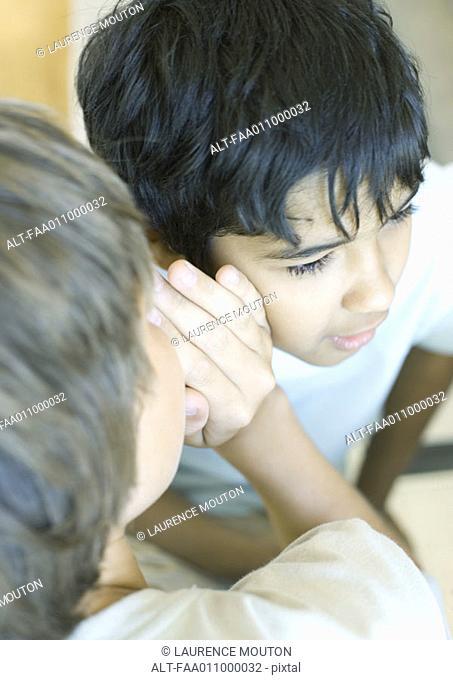 Teen boy whispering to friend