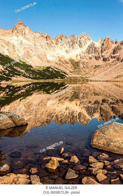 Mirror image of mountain landscape in Tonchek lake, Nahuel Huapi National Park, Rio Negro, Argentina
