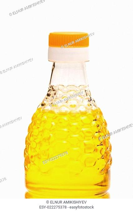 Close up of oil bottle isolated on white