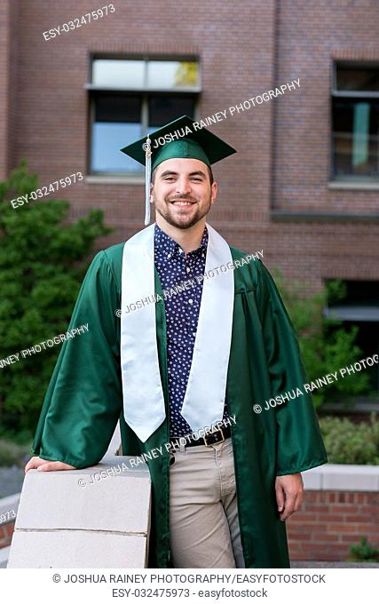College student graduation lifestyle portrait on campus at a university