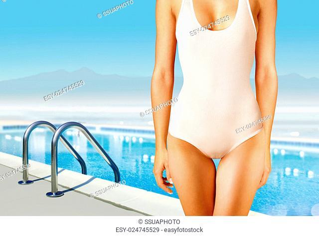 part of woman in white swimwear near swimming pool
