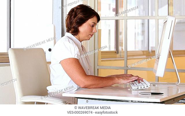 Businesswoman working at her desk