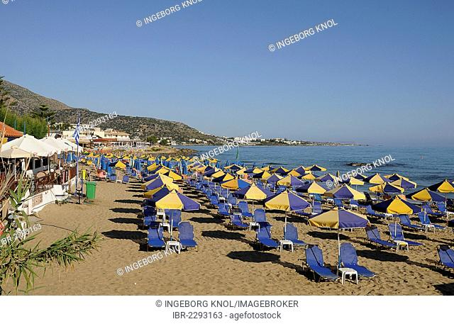 Parasols, sunbeds, beach, Malia, Crete, Greece, Europe