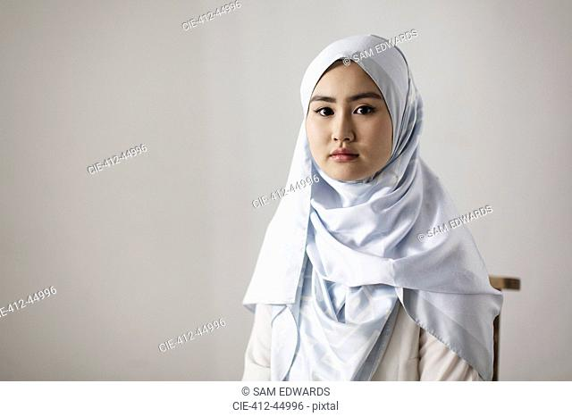 Portrait confident, serious young woman wearing hijab
