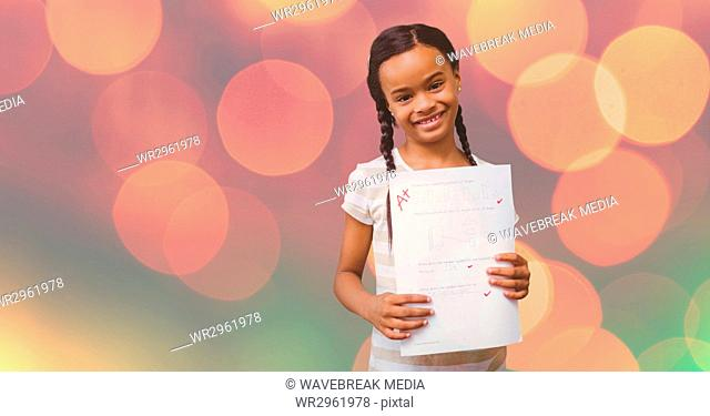 Portrait of girl showing A plus grade over bokeh