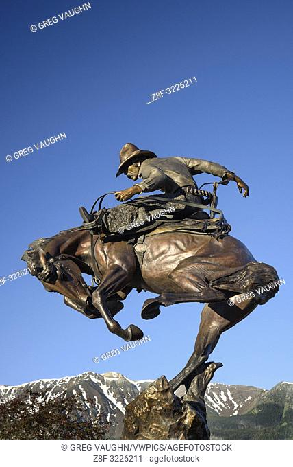 """""""""""Attitude Adjustment"""" bronze sculpture of cowboy and bucking bronco by Austin Barton in downtown Joseph, Oregon"
