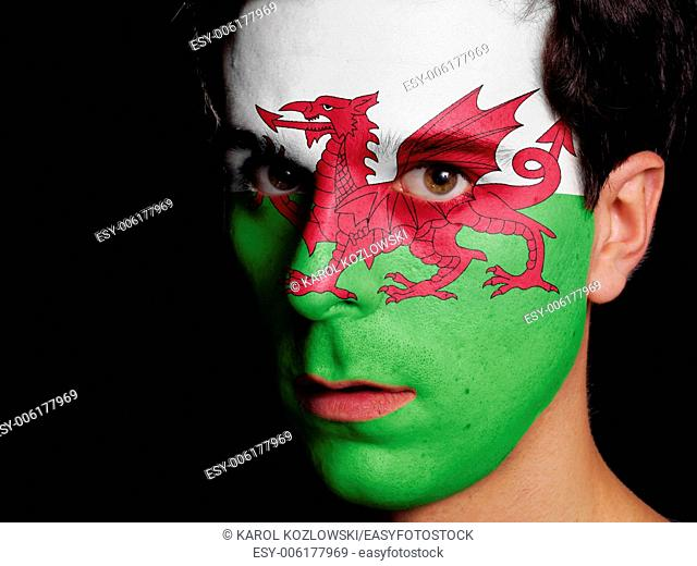 Flag of Wales Painted on a Face of a Young Man
