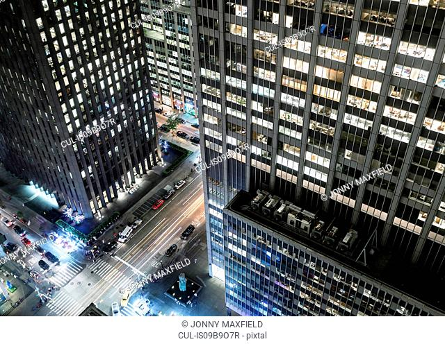 Elevated view of street at night, skyscraper in foreground, New York City, New York, USA