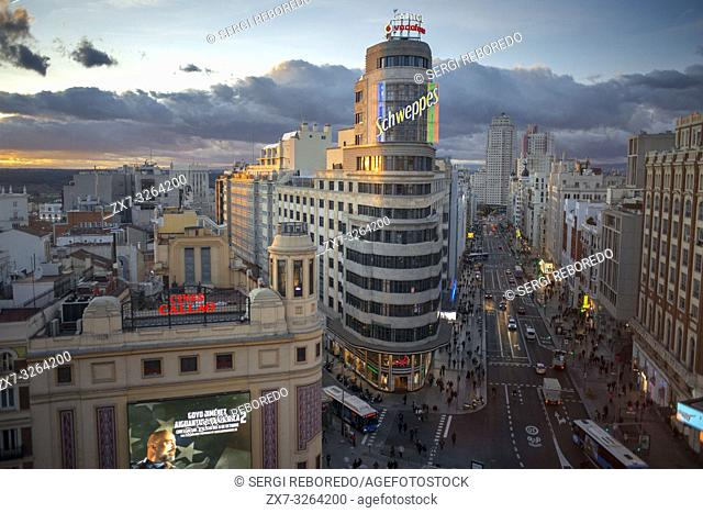 Capitol building, Gran Via at the Iconic Schweppes Building. The street is the main shopping district of Madrid, Spain