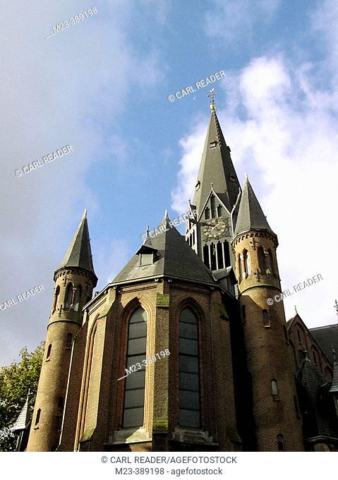 A Vondel Street church in Amsterdam stands beneath the moon