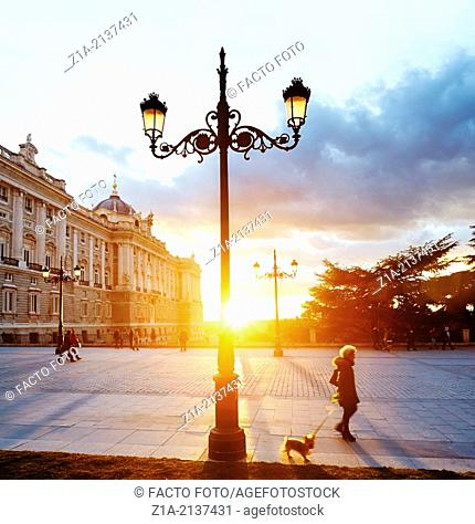 People walking along the Royal Palace of Madrid. Spain