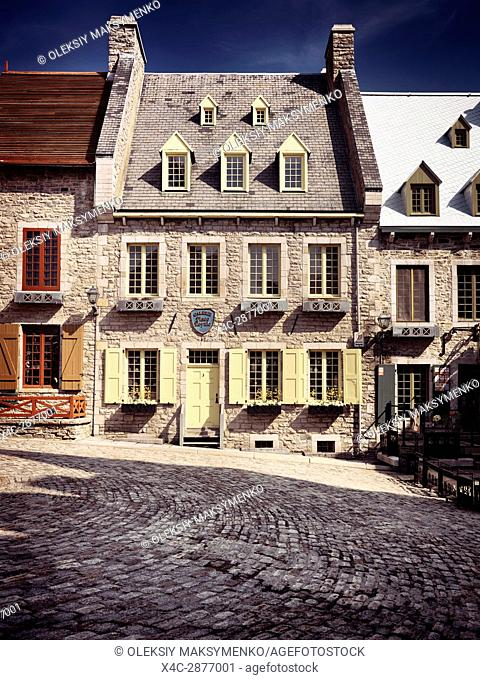 Historic architecture of Galerie Place Royale building in Royal Square on a bright sunny day in Old Quebec City. Quebec, Canada