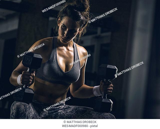 Female athlete with hand dumbbells