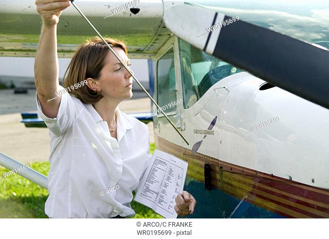 Woman, with, sporting, airplane