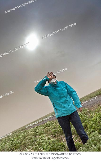 Grimsvotn Volcanic Eruption in the Vatnajokull Glacier, Iceland Woman wipes the ash from her eyes   May 21, 2011 eruption began spewing tons of ash