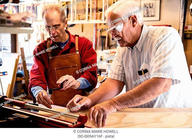 Senior men working with carpentry equipment workshop