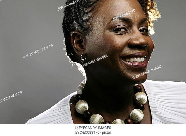 Close-up portrait of young African American woman, studio shot