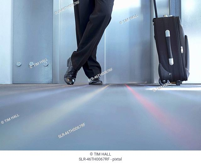 Businessman standing with luggage