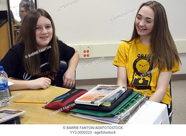 7th Grade Girls Chatting in Classroom, Wellsville, New York, USA
