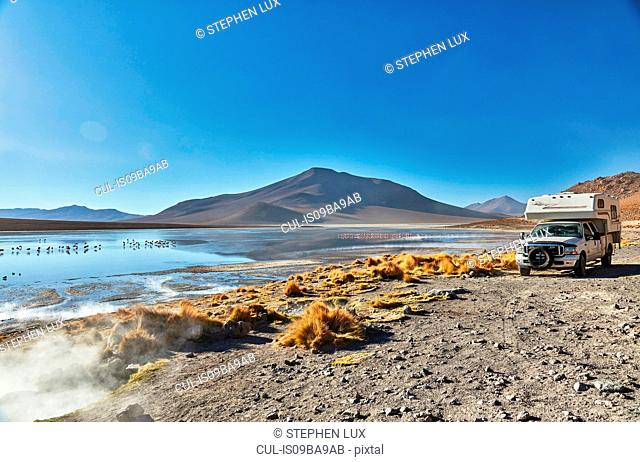 Recreational vehicle moving across landscape, Chalviri, Oruro, Bolivia, South America