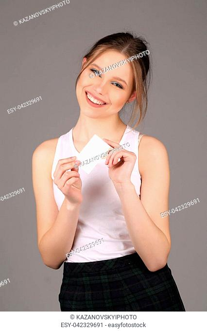 Smiling model posing with note, high fashion look, perfect make-up, beautiful girl, smiling girl, isolated, looking into the camera, clear skin,big lips