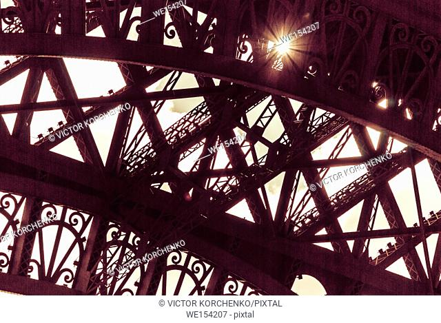 Lace wrought iron structure of Eiffel Tower in Paris