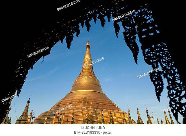 Ornate temple under blue sky, Yangon, Yangon Region, Myanmar