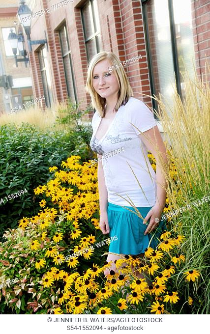 A happy young woman in a garden of Black-eyed Susan flowers, Lewiston, Idaho, USA
