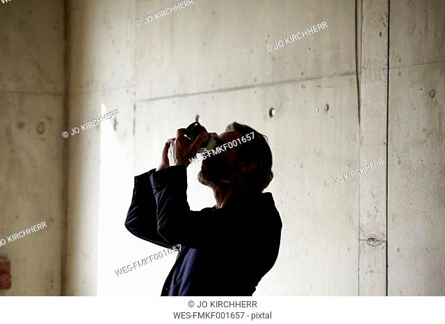 Man taking picture on construction site