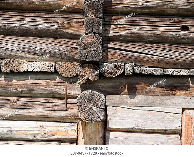 Old log cabin wood wall. background