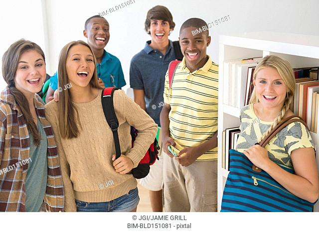 Teenage students smiling at school