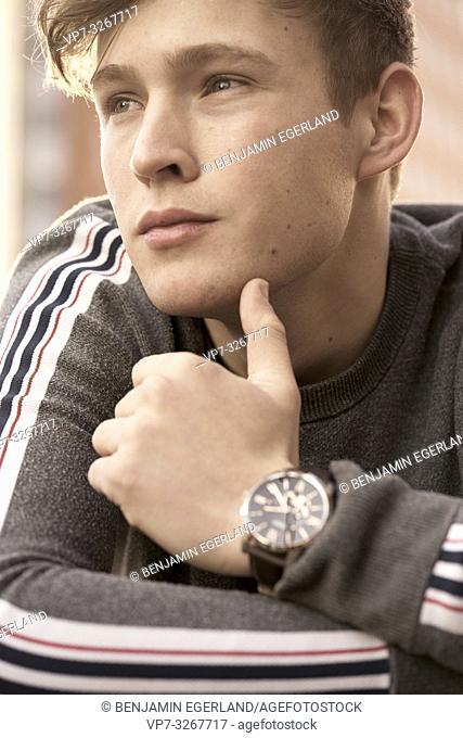 young thoughtful model man looking sideways, in Hamburg, Germany