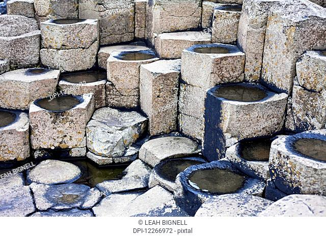 Pools of water formed in the columns of Giant's Causeway, Causeway Coast; County Antrim, Ireland