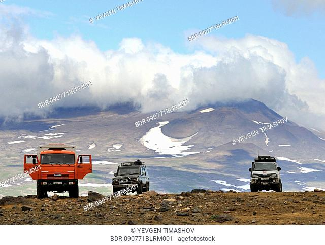 off-road vehicles waiting in Mutnovsky volcano area on Kamchatka