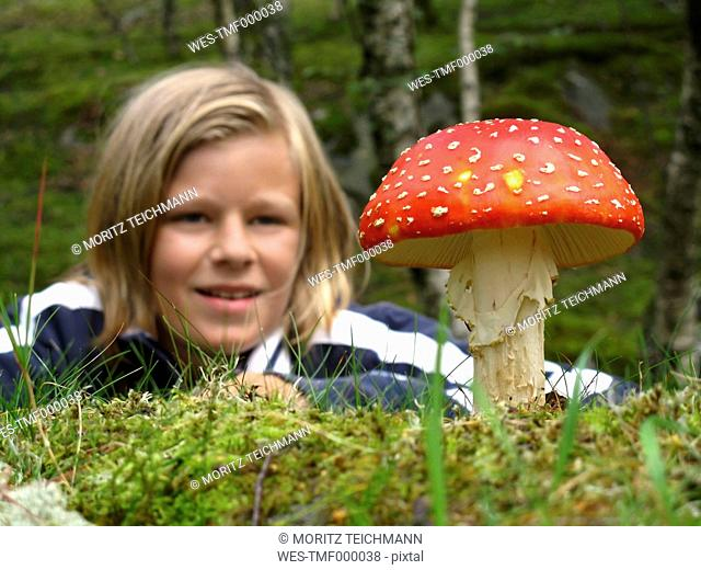Boy discovering fly agaric