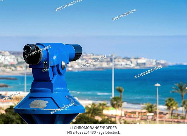 Coin-operated binoculars on the promenade of Playa del Ingles, overlooking San Agustin