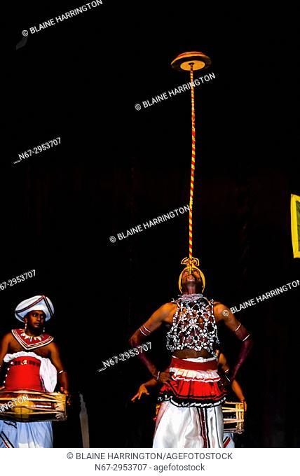 "Balancing spinning disks, """"Dances of Sri Lanka"""" cultural performance, Kandy, Central Province, Sri Lanka"