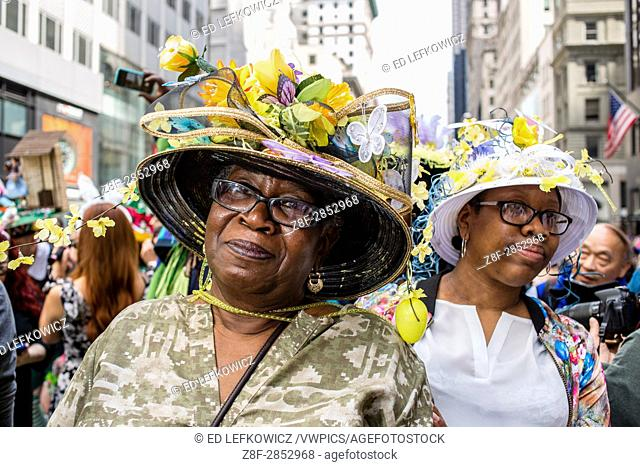 New York, NY - April 16, 2017. A woman with an elaborate hat with decorations of flowers and butterflies at New York's annual Easter Bonnet Parade and Festival...