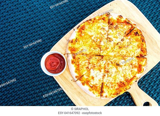 Seafood pizza on wood tray and tomato sauce