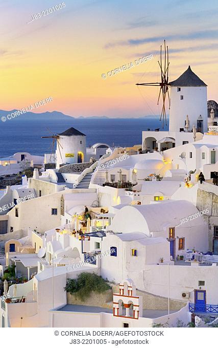 View of Oia with traditional greek windmill of Santorini, Oia Village, Santorini, Aegean Island, Cyclades Islands, Greek Islands, Greece, Europe